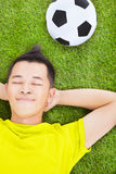 Young man lying on a meadow Royalty Free Stock Photography