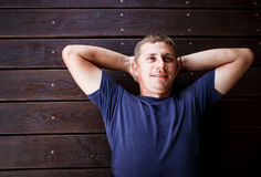 Young man lying and relaxing on wooden deck outdoor. stock photos