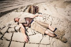 Young man. Lying on the sand Royalty Free Stock Photos