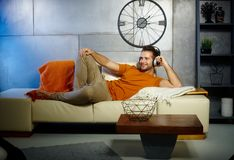 Young man relaxing at home stock image