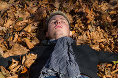 Young man lying in the sun Royalty Free Stock Photo