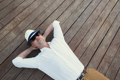 Young man lying on wooden deck Royalty Free Stock Image