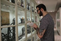 Man in Shop reading stock photos