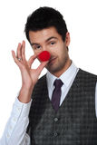 Young man magican making clown nose Royalty Free Stock Image