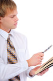 Young man with magnifier by read book Stock Images