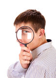 Young Man with Magnifying Glass Royalty Free Stock Images