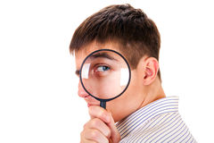 Young Man with Magnifying Glass Royalty Free Stock Photography