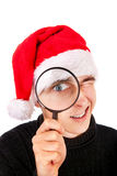Young Man with Magnifying Glass Royalty Free Stock Image