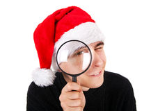 Young Man with Magnifying Glass Stock Images