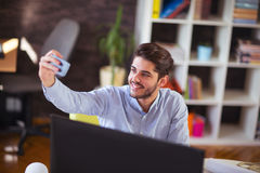 Young man make selfie photo with  phone. In office Stock Image