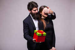 Young man make a surprise gift for his girlfriend Royalty Free Stock Photos