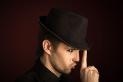 A young man  with  make  up and painted tears. Stock Photo