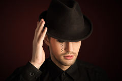 A young man  with  make  up and painted tears. Stock Photos