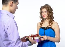 Young man makes a gift to his girlfriend Royalty Free Stock Images