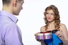 Young man makes a gift to his girlfriend Royalty Free Stock Photos
