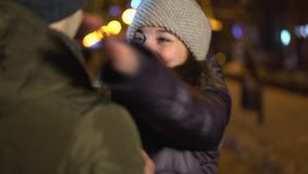 Boyfriend making proposal while giving an engagement ring to his girlfriend. Young man makes marriage proposal to his girlfriend at city center stock footage
