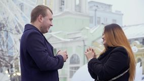 Young man makes marriage proposal to his girlfriend at ferris wheel background. Young man makes a marriage proposal to his girlfriend standing at the background stock video