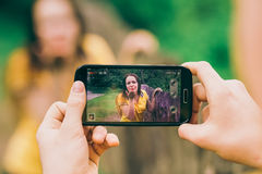 Young man makes photo of girl friend Royalty Free Stock Photo