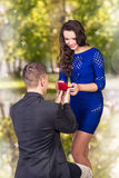 Young man makes a proposal his girlfriend Royalty Free Stock Photo