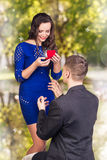Young man makes a proposal his girlfriend Stock Photo