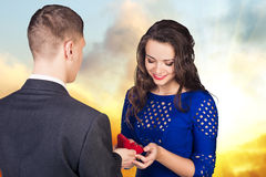 Young man makes a proposal to his girlfriend stock photos