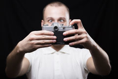 A young man makes a selfie using the retro camera Stock Photos