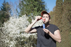 Young man makes soap bubbles Stock Photography