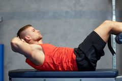 Young man making abdominal exercises in gym Royalty Free Stock Photography