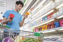 Young Man Making Decisions About Food in Supermarket Stock Photos