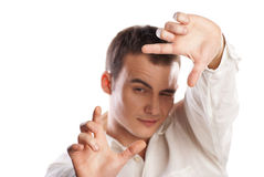 Young man making frame with finger on white Stock Photo