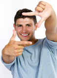 Young man making frame with his hands Royalty Free Stock Image