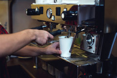 Young man is making fresh coffee with. Coffeemachine Stock Images
