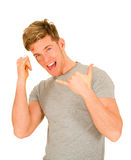Young man making hang loose hand signals Stock Photo