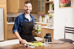 Young man making a healthy drink Stock Photography