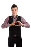 Young man making heart with fingers Stock Photography