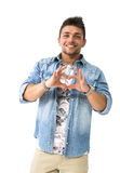 Young man making heart sign with his hands Royalty Free Stock Images