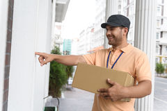 Young man making home delivery Royalty Free Stock Images