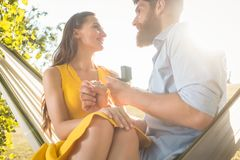 Young man making marriage proposal to beautiful girlfriend while Stock Images