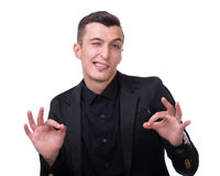 Young man making the ok hand sign Royalty Free Stock Photos