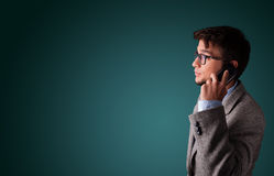 Young man making phone call with copy space Royalty Free Stock Photography