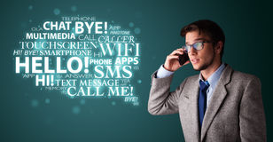 Young man making phone call with word cloud Stock Photos