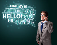 Young man making phone call with word cloud Royalty Free Stock Image