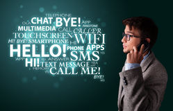 Young man making phone call with word cloud Stock Photo