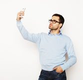 Young man making photo of himself Stock Photo