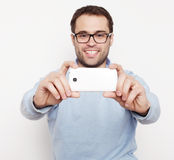 Young man making photo of himself Stock Photography