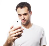 Young man making photo of himself Royalty Free Stock Images