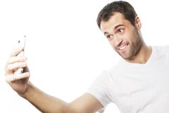 Young man making photo of himself Stock Images
