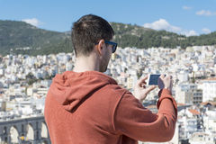 Young man  making pictures of the cityscape in Kavala,Greece Stock Photography