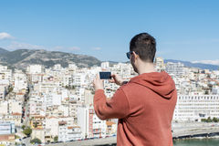 Young man  making pictures of the cityscape in Kavala,Greece Stock Photos