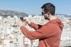 Young man  making pictures of the cityscape in Kavala,Greece Royalty Free Stock Photography
